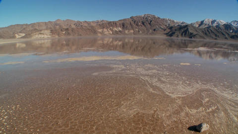 A pan across a lake of badwater in Death Valley National... Stock Video Footage