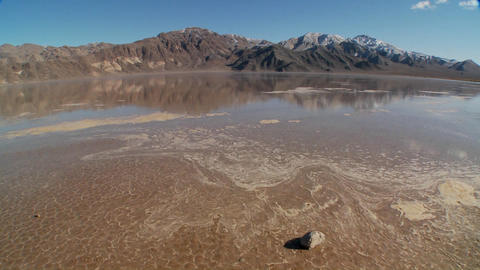 A pan across a lake of badwater in Death Valley National Park Footage