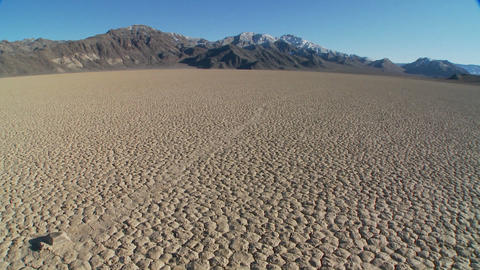 The mysterious rocks which race across the dry lakebed known as the Racetrack in Death Valley Footage