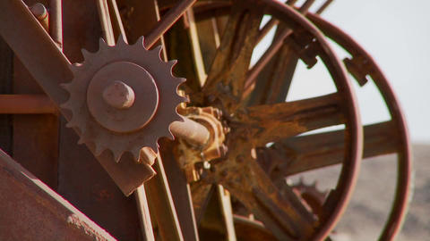 Old cogwheels rust in the sun at an abandoned mine Footage