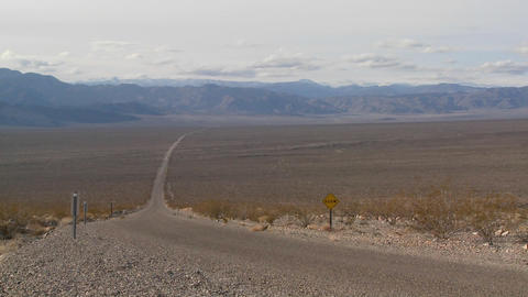 A lonely highway goes across the desert Footage