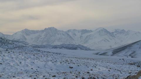 Winter light shines down on a snowy Sierra Nevada landscape Stock Video Footage