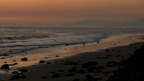 A beautiful sunset behind the California coastline near... Stock Video Footage