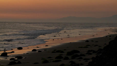 A beautiful sunset behind the California coastline near Santa Barbara Footage