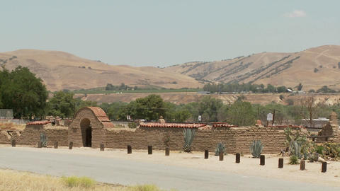An Amtrak train passes a California mission Stock Video Footage