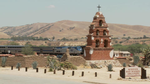 An Amtrak train passes a California mission Footage
