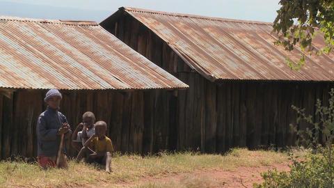 African children sit near a slum Stock Video Footage