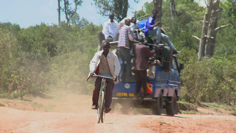 A van crowded with passengers makes its way along a dirt... Stock Video Footage