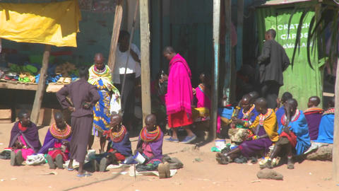 Colorful tribal people line the dirt streets of Maralal,... Stock Video Footage