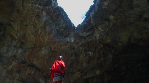 Majestic shot of a Masai warrior standing in a cave in Kenya Footage