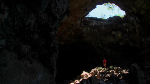 A Masai warrior is bathed in a pool of light in a cave in... Stock Video Footage