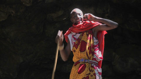 A Masai warrior boy talks on a cell phone Footage