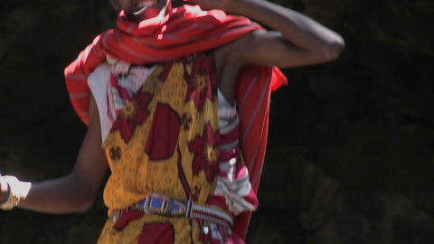 Tilt up to a Masai man speaking on a cell phone Footage