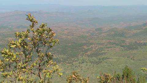 A Masai warrior standings at the edge of a canyon in... Stock Video Footage