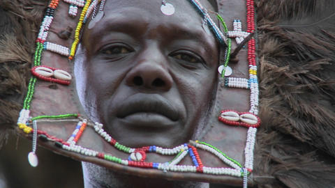 An extreme close up of a face of a Masai warrior with full headdress Footage