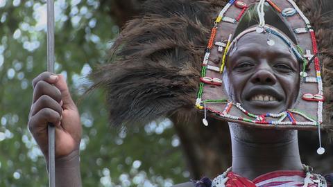 A Masai warrior in full headdress smiles Stock Video Footage