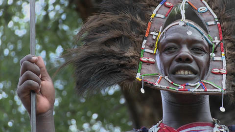 A Masai warrior in full headdress smiles Stock Video Footage