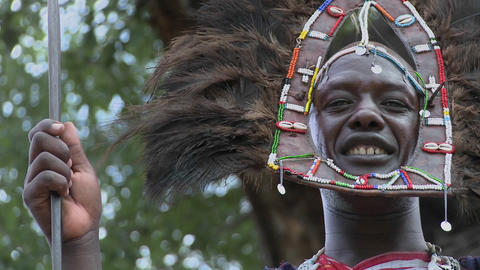 A Masai warrior in full headdress smiles Footage