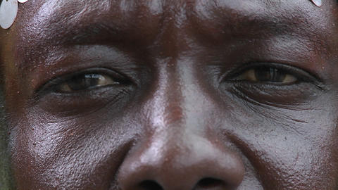 Extreme close up of the eyes and nose of an African man Footage