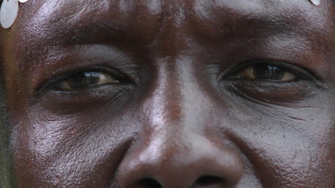 Extreme close up of the eyes and nose of an African man Stock Video Footage