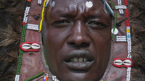A good closeup of a Masai tribal warriors face with beads... Stock Video Footage