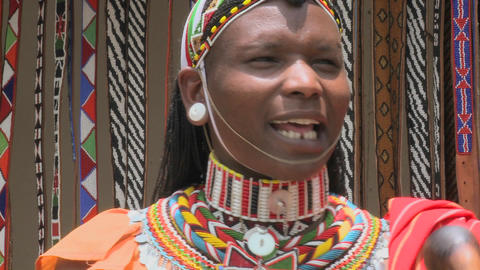 A smiling Masai man with beads and full costume Stock Video Footage
