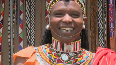 A smiling Masai man with beads and full costume Footage
