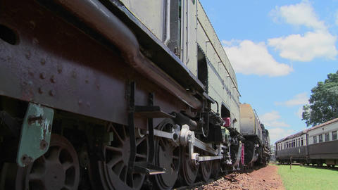 Old trains sit abandoned in a railyard in this time lapse... Stock Video Footage