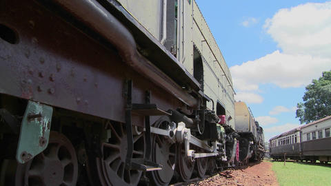 Old trains sit abandoned in a railyard in this time lapse shot Footage