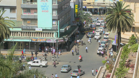 Pedestrians walk on busy streets in Nairobi, Kenya Stock Video Footage