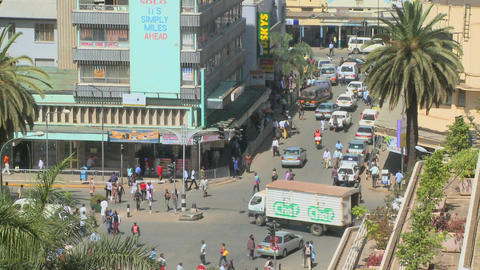 Pedestrians walk on busy streets in Nairobi, Kenya Stock Video Footage