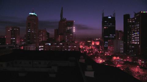 Slow pan across night skyline of Nairobi, Kenya Stock Video Footage