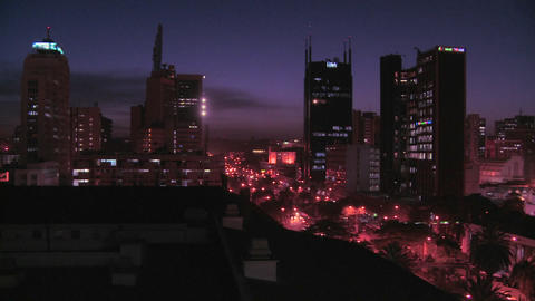 Slow pan across night skyline of Nairobi, Kenya Stock Video Footage
