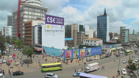 Wide shot of downtown Nairobi Kenya with traffic and pedestrians Footage