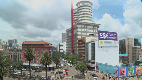Slow tilt down to streets of Nairobi, Kenya with pedestrians and traffic Footage