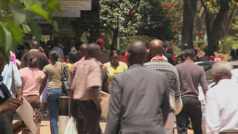 Crowds of people walk on the streets of Nairobi, Kenya Stock Video Footage