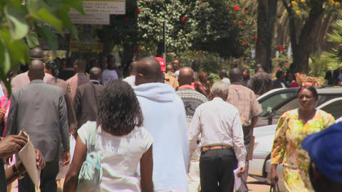 Crowds of people walk on the streets of Nairobi, Kenya Footage