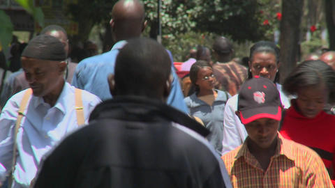 Crowds of pedestrians walk on the modern streets of Nairobi, Kenya Footage