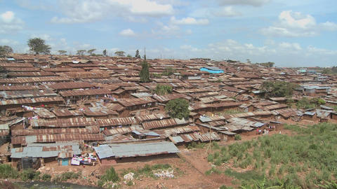 View across a poverty stricken slum in Nairobi Kenya Stock Video Footage