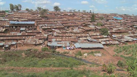 Pan across a slum in Nairobi, Kenya Stock Video Footage