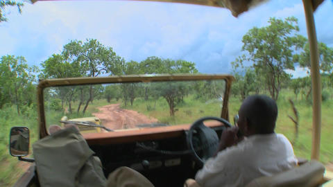Point of view of a driver driving on a dirt road in Africa Stock Video Footage