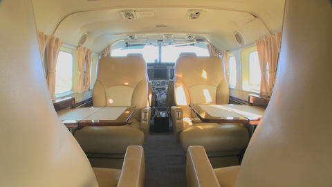 Dolly forward through the interior of a corporate luxury jet Stock Video Footage