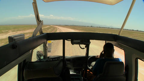 POV shot driving in an open topped safari vehicle through Africa Footage