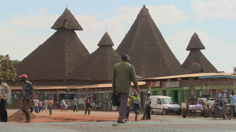 Unusual Thatch Roof Structures In Kenya Are A Community Market stock footage