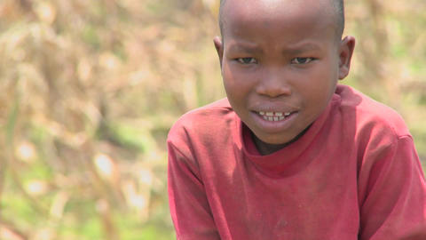 A young man smiles at the camera in Africa Stock Video Footage