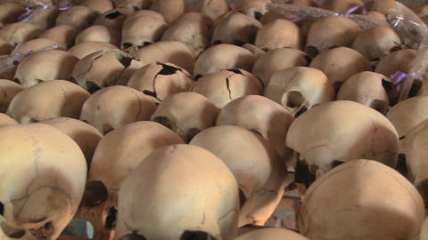 Pan across hundreds of skulls crushed during the genocide... Stock Video Footage