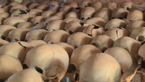 Pan across hundreds of skulls crushed during the genocide in Rwanda Footage