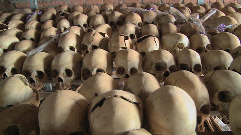 Dolly along hundreds of skulls in rows in a church... Stock Video Footage