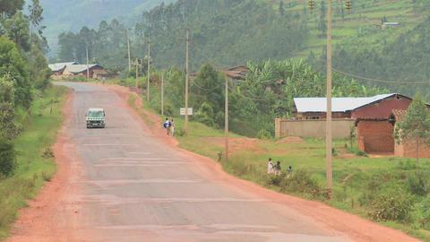 A minibus travels down a rural road in Rwanda Stock Video Footage