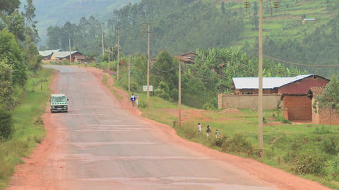 A minibus travels down a rural road in Rwanda Footage